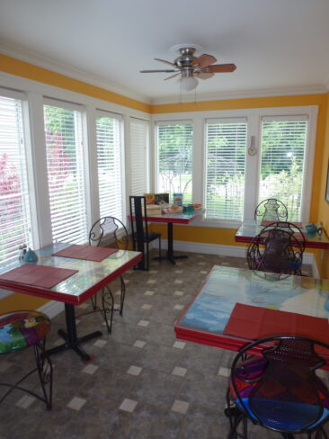 We offer bistro-style seating for guests in our sunny breakfast room at Globetrotters B&B/Gallery in Niagara-on-the-Lake.